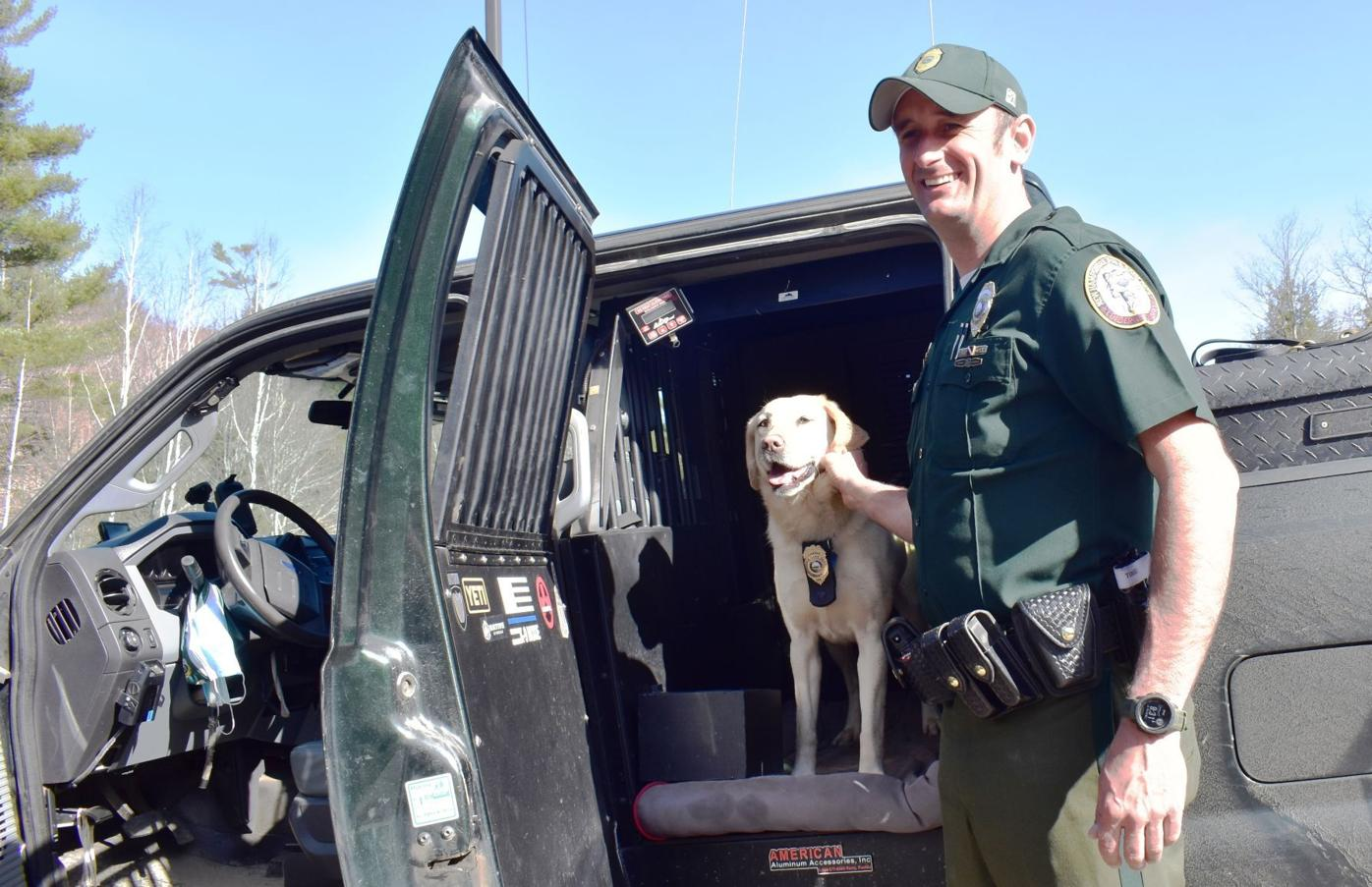 Conservation Officer Eric Fluette and Moxie