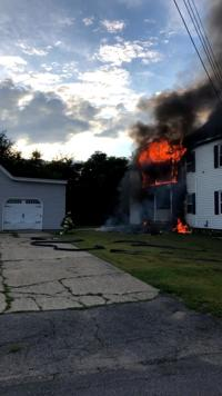 Manchester crews battle two-alarm house fire