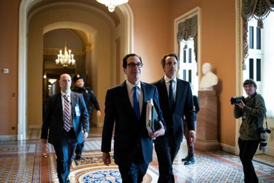 U.S. Secretary of the Treasury Steven Mnuchin walks to a meeting during negotiations on a coronavirus disease (COVID-19) relief package