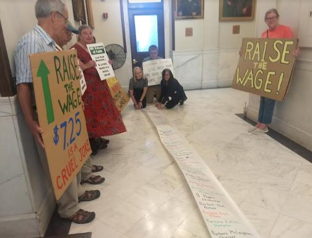 Dems unfurl petition backing minimum wage hike