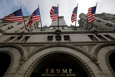 FILE PHOTO: U.S. flags fly over the Trump International Hotel in Washington