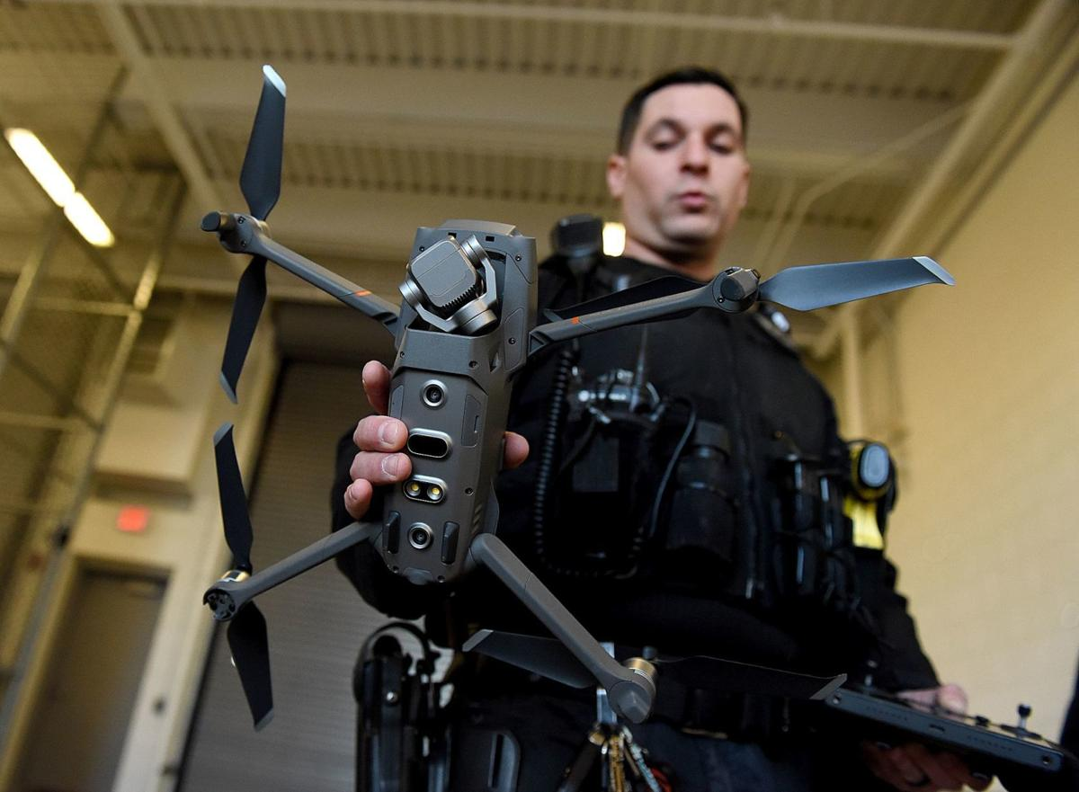 Manchester Police Officer Joseph Tucker holds Manchester's new police drone