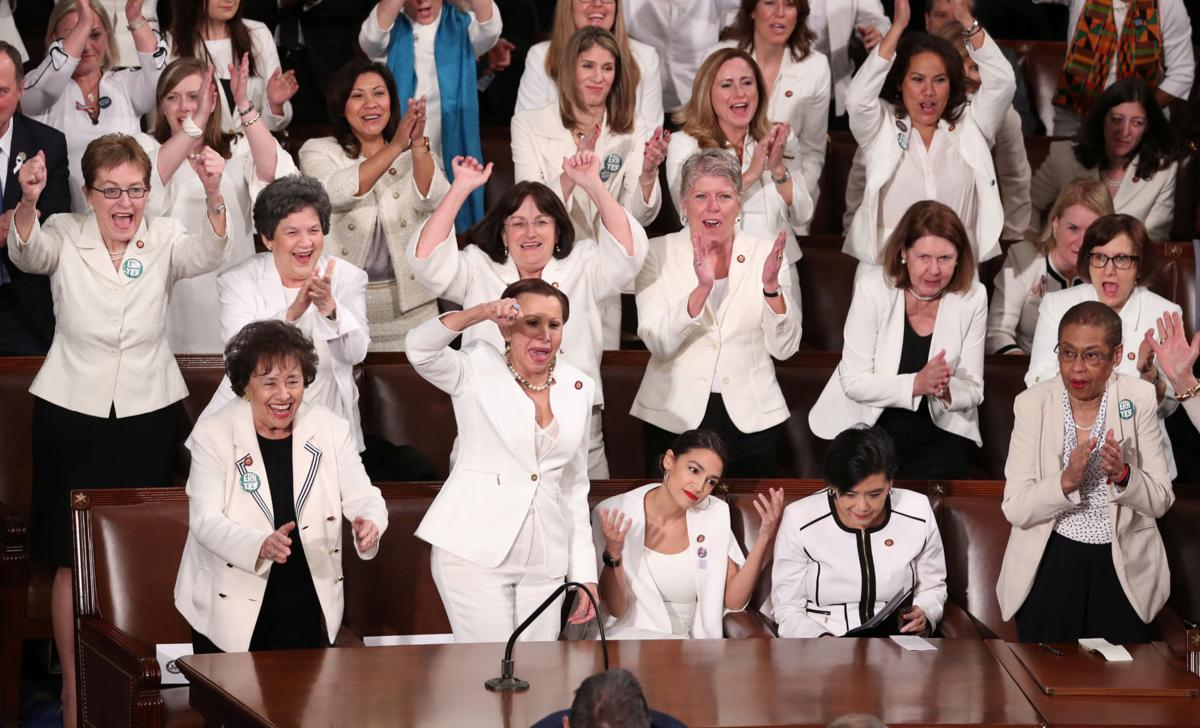 Democratic female members of Congress cheer during U.S. President Trump's second State of the Union address to a joint session of the U.S. Congress in Washington