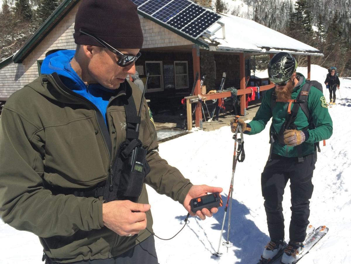 190421-lif-snowranger03 UL_SnowRangers_Jeff-checking beacon_McPhaul