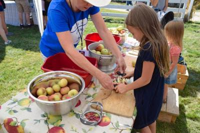 Toss a skillet, husk some corn and greet animals during Harvest Festival