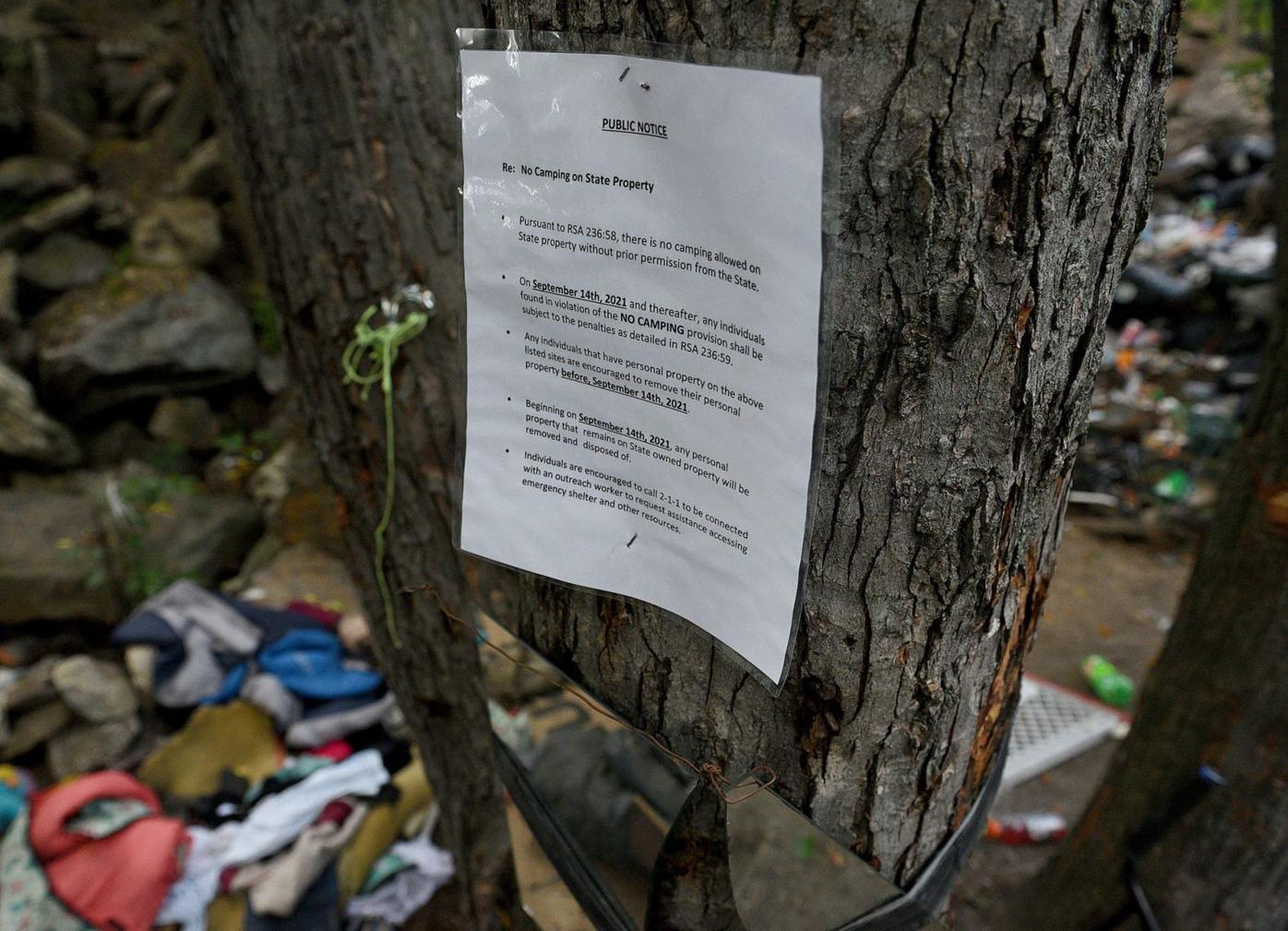 Sign warns Manchester homeless camp residents