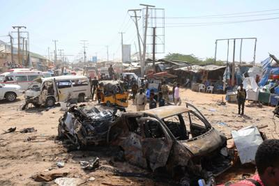 A general view shows the scene of a car bomb explosion at a checkpoint in Mogadishu