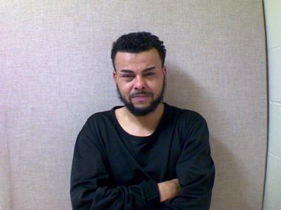 Hudson police arrest man found hiding under blanket in back seat of car