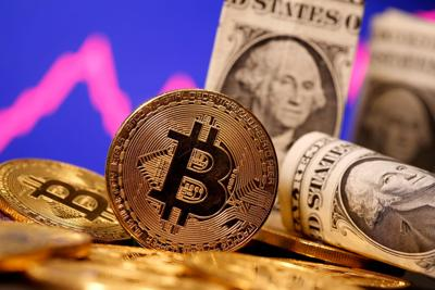 FILE PHOTO: FILE PHOTO: A representation of virtual currency Bitcoin and U.S. One Dollar banknotes are seen in front of a stock graph in this illustration