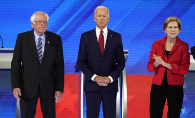 Senator Bernie Sanders joins former Vice President Joe Biden and Senator Elizabeth Warren onstage before the start at the 2020 Democratic U.S. presidential debate in Houston