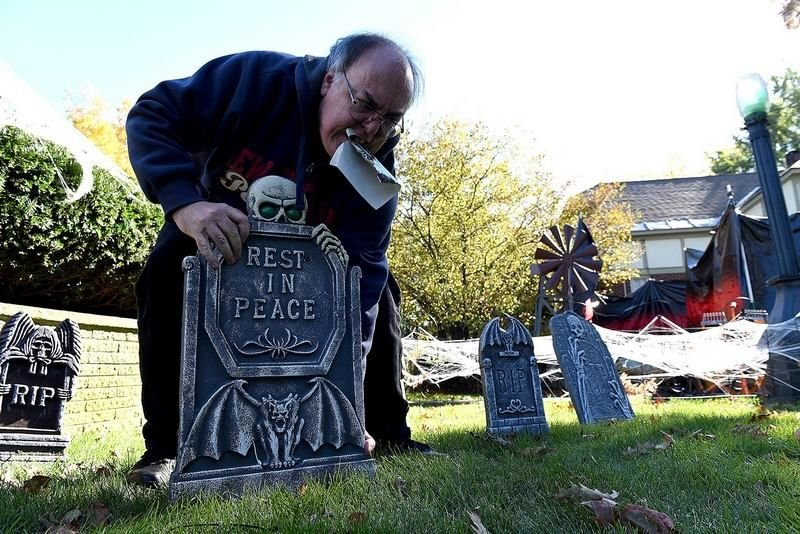 Rick Pierce sets up his pop-up haunted house