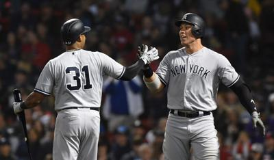 Yanks rout Sox, clinch home field