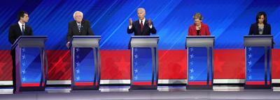 Former Vice President Biden speaks as South Bend Mayor Buttigieg and Senator Sanders, Warren and Harris listen during the 2020 Democratic U.S. presidential debate in Houston, Texas, U.S.