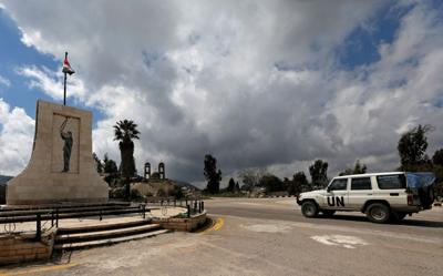 FILE PHOTO: A U.N vehicle drives in Quneitra, near the Israeli-occupied Golan Heights