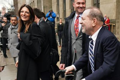 Film producer Harvey Weinstein jokes with his attorney Donna Rotunno after he made a statement to the media as he departs New York Criminal Court during his ongoing sexual assault trial in the Manhattan borough of New York City