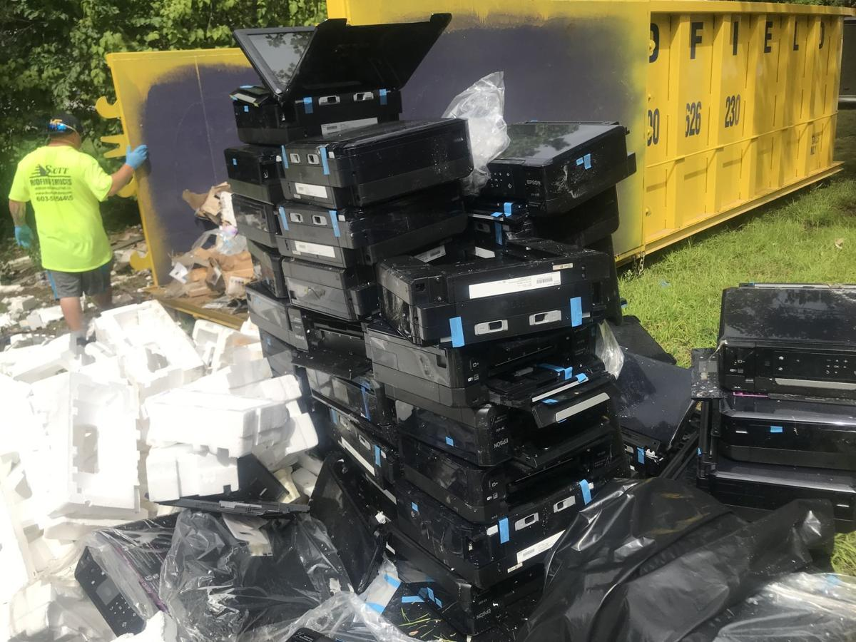 Image result for New Owner of Property with  Mega Printer Pile Begins Painstaking Cleanup.