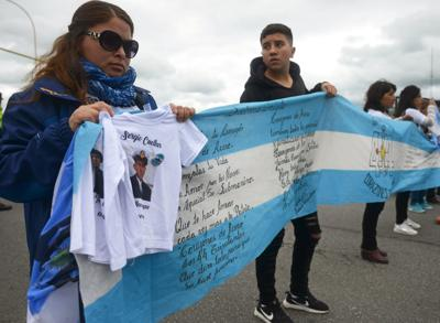 Relatives of the 44 crew members of the missing at sea ARA San Juan submarine attend a demonstration outside the Argentine Naval Base where the submarine sailed from, in Mar del Plata
