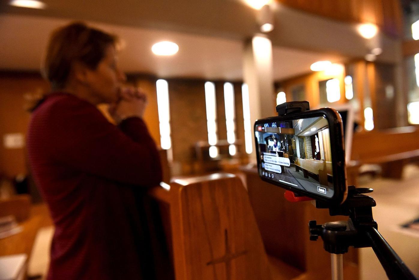 Parish secretary Kerri Stanley prays