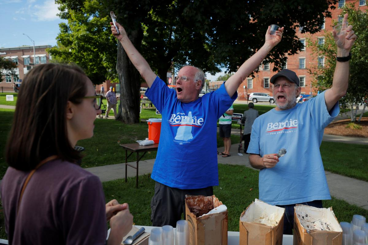 Ben Cohen and Jerry Greenfield serve Ben and Jerry's ice-cream before a campaign rally with Democratic 2020 U.S. presidential candidate Sanders in Dover