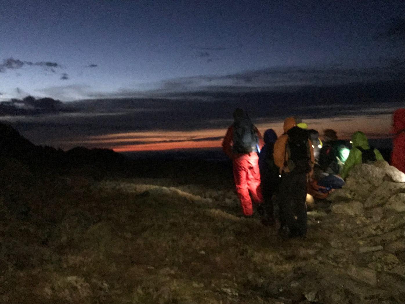 Rescuers carry James Clark off Mount Washington