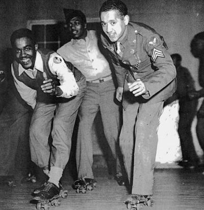 WWII soldiers roller-skating at Grenier Field