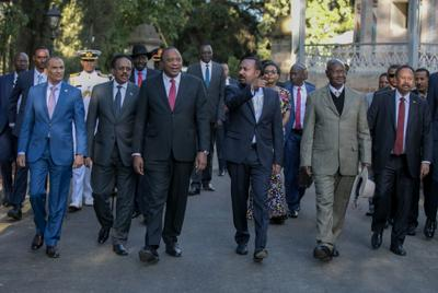 Ethiopian PM Abiy Ahmed walks with foreign dignitaries in Addis Ababa