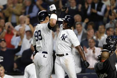 Judge, Stanton power Yanks past A's in wild-card game, setting up series with Red Sox
