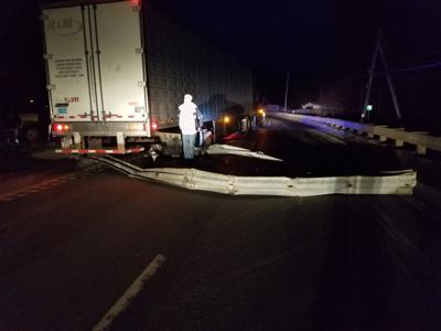 Tractor trailer takes out guardrail