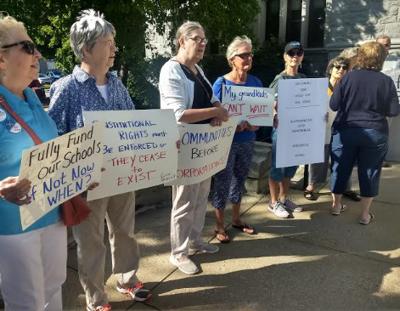 Advocates urge lawmakers to keep ed aid promises