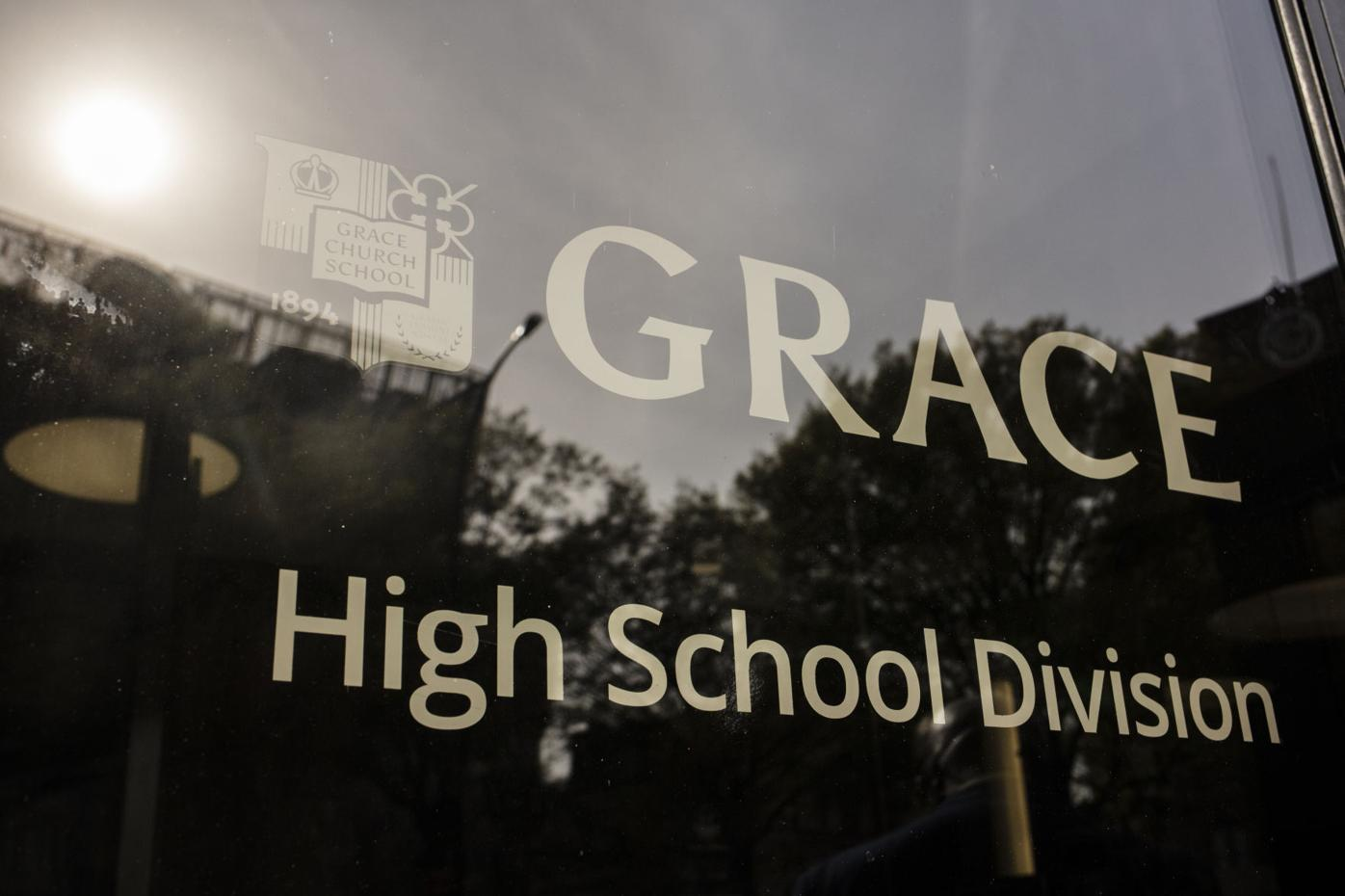 A sign on a window of Grace Church School.