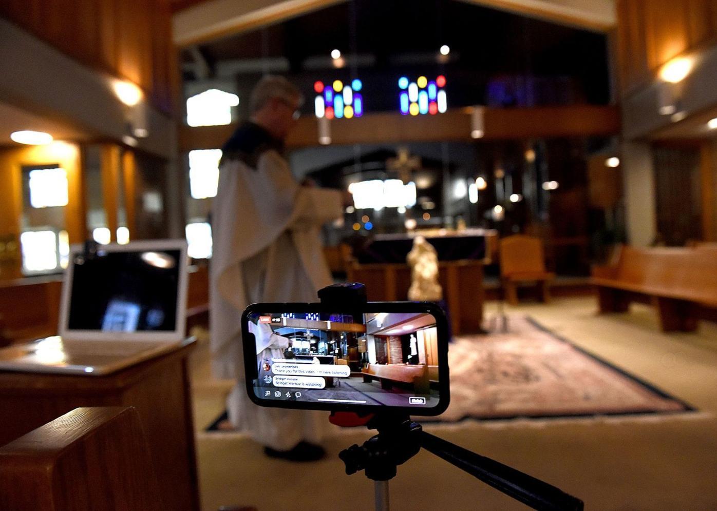 A cellphone captures the Rev. Jerome Day celebrating Mass