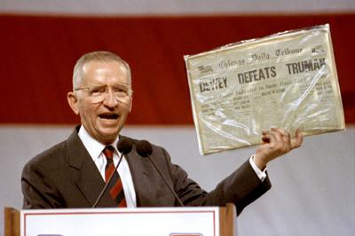 Independent Presidential candidate Ross Perot holds aloft historic newspaper