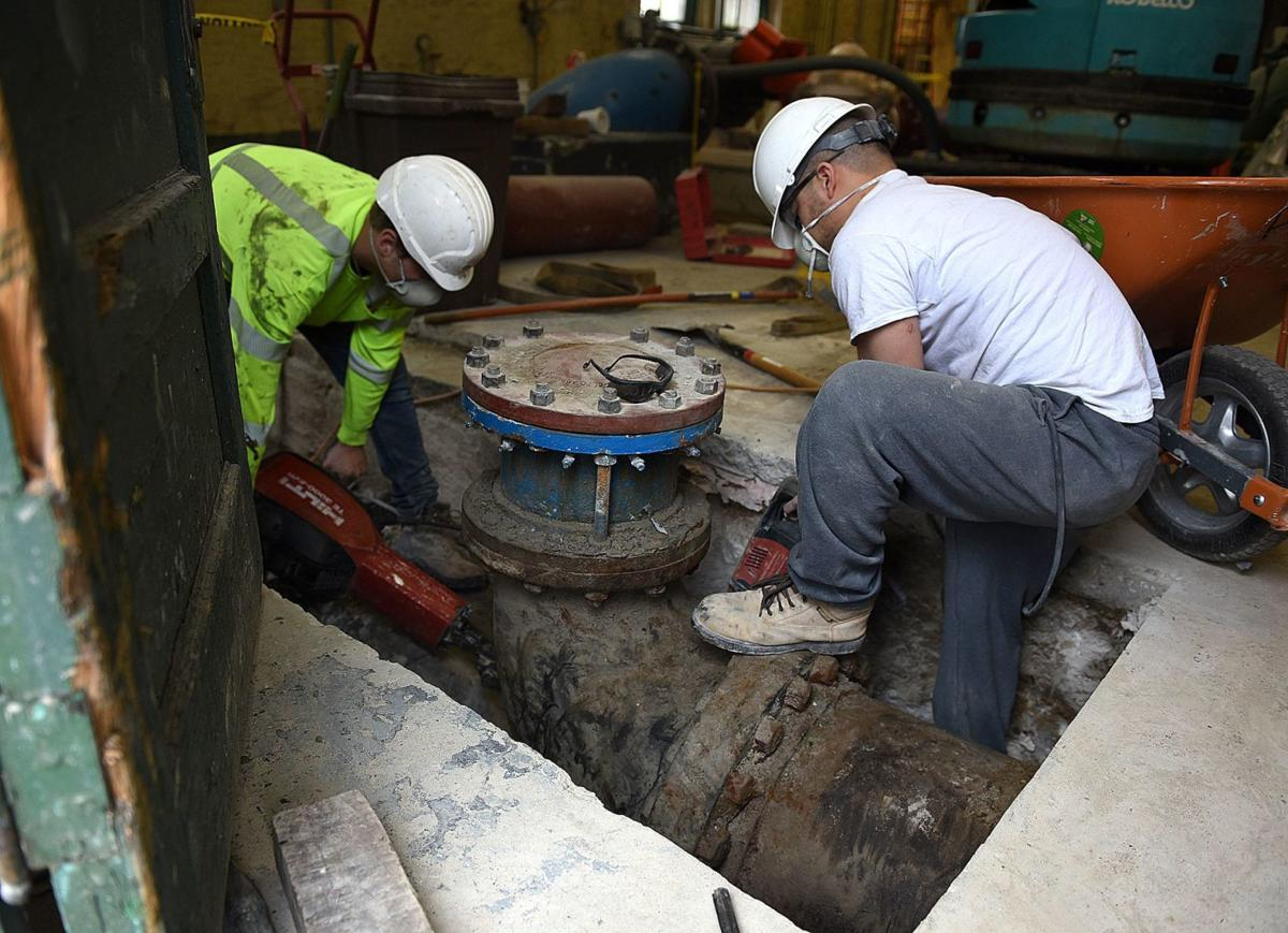 Workers replacing 16-inch water line at Cohas Pumping Station in Manchester