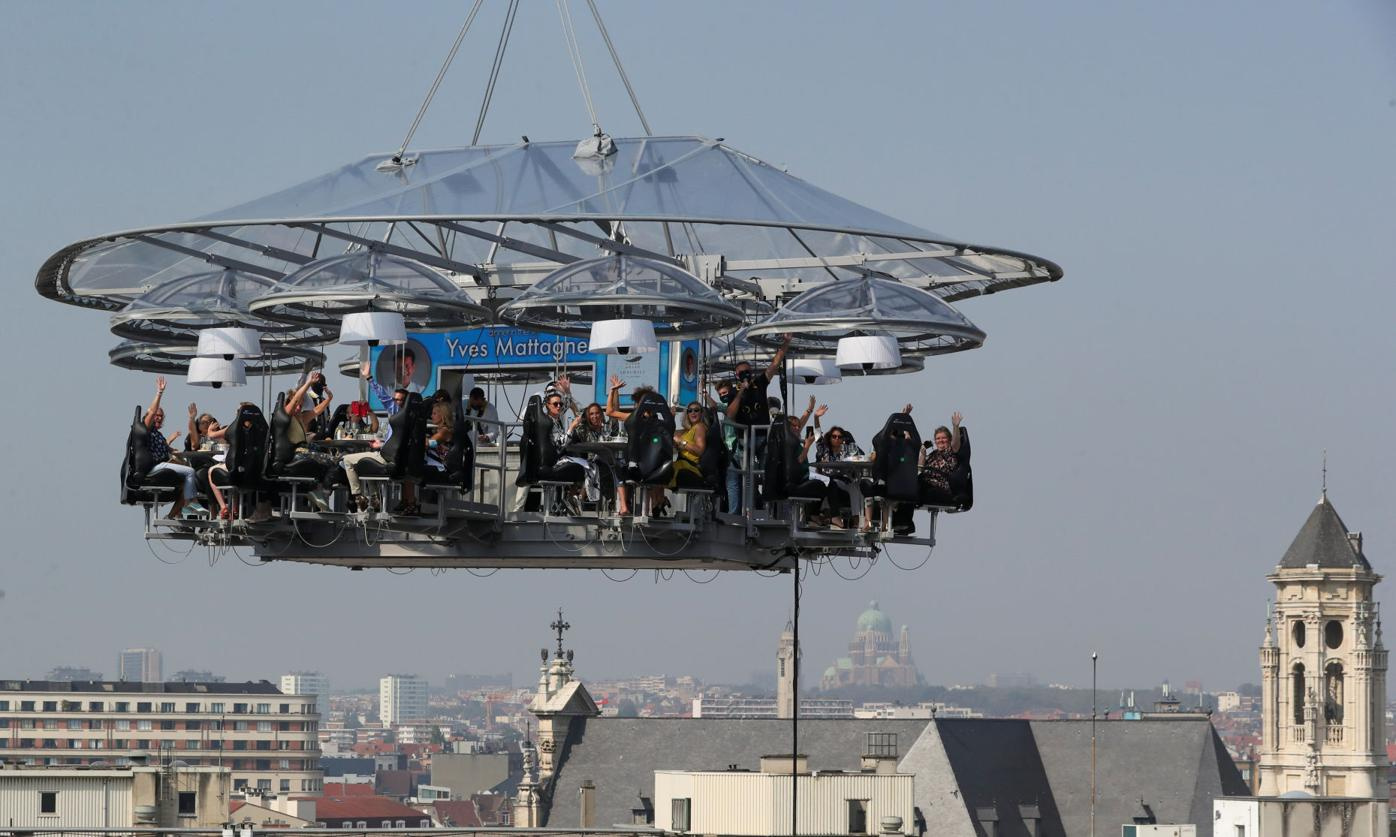 "People sit at a table during ""Dinner in the Sky 2.0 New Generation"" in Brussels"