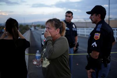 A woman reacts after a mass shooting at a Walmart in El Paso