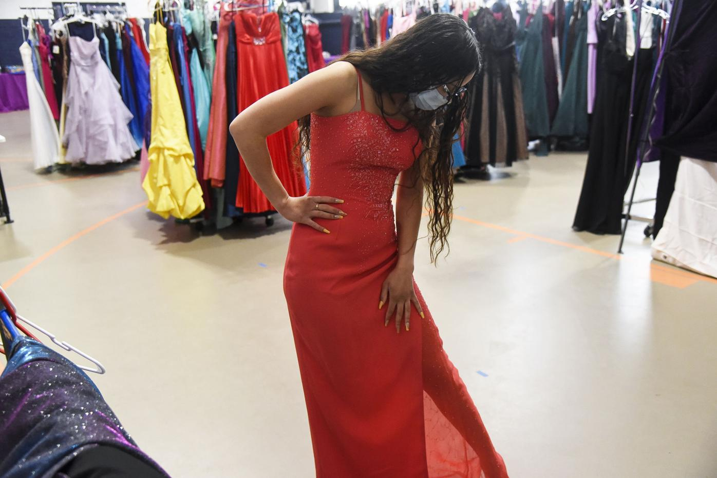 Alize Rivera tries on a prom dress