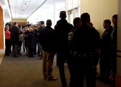 Police officers outside courtroom