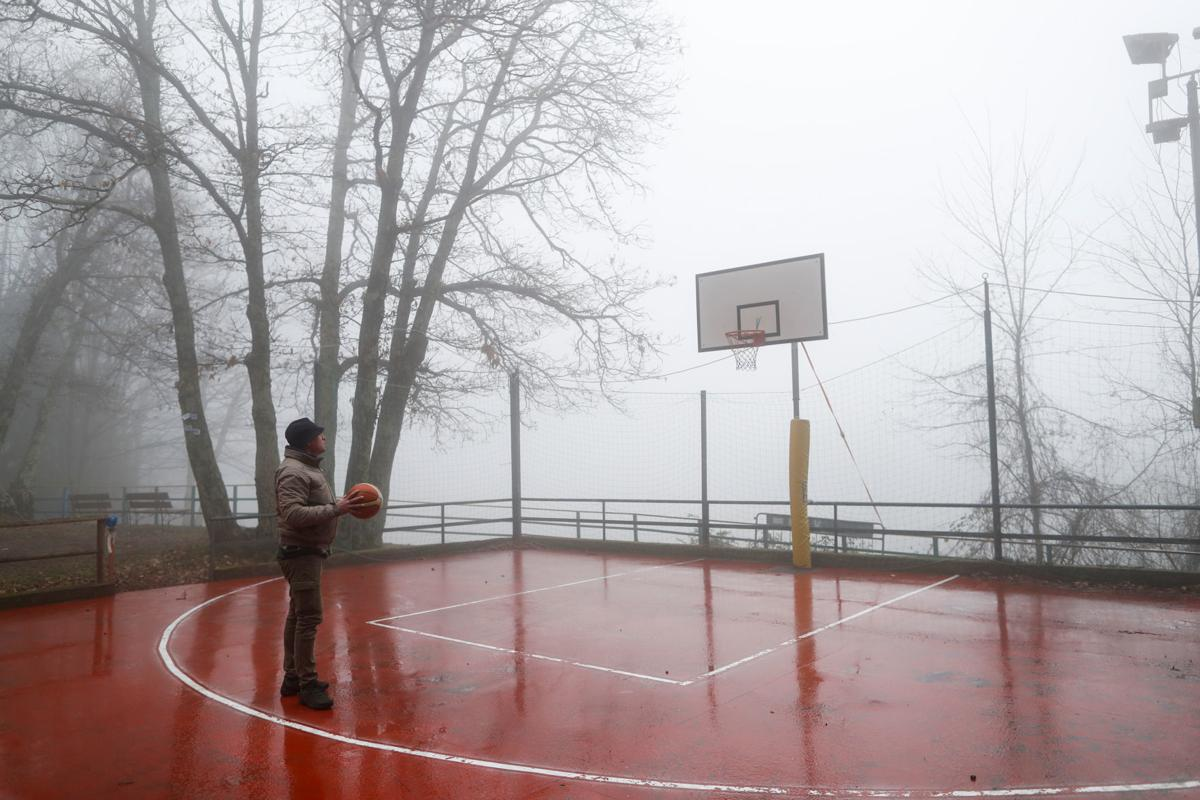 Kobe Bryant's childhood friend Michele Rotella walks in the basketball court where Kobe Bryant used to play when he was young, in Cireglio