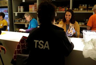 A TSA worker receives food at the Lakeview Pantry in Chicago