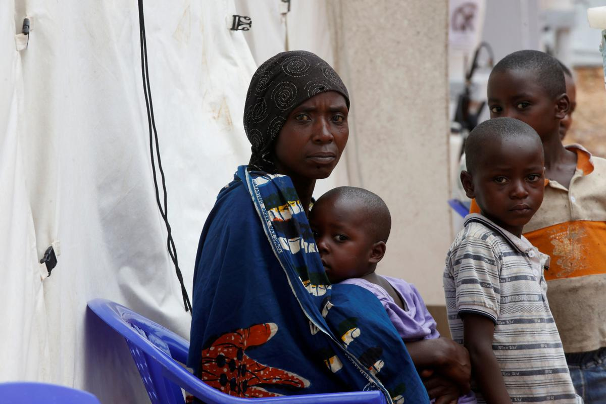 Patients sit at the Ebola treatment center in Butembo