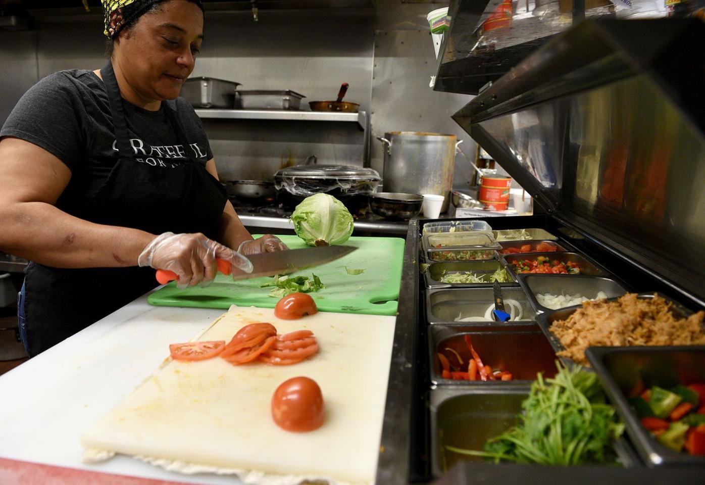 Eduarda Batista MacDonald chops vegetables