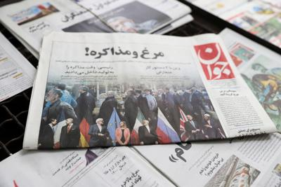 A newspaper with a front picture regarding Iran P5+1 talk is seen in Tehran