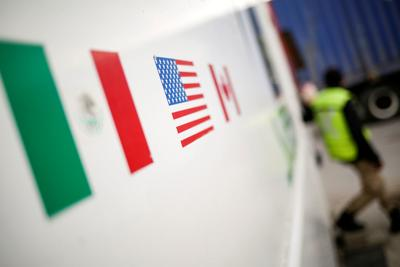 Flags of Mexico, United States and Canada are pictured at a security booth at Zaragoza-Ysleta border crossing bridge, in Ciudad Juarez