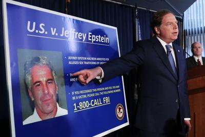 Geoffrey Berman points to a photograph of Jeffrey Epstein in New York