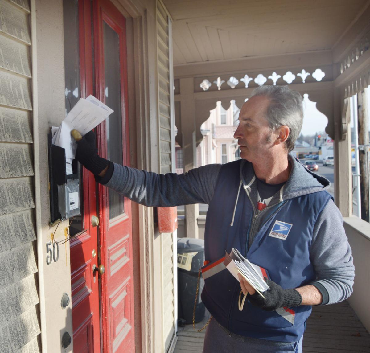 Retired letter carrier delivering mail