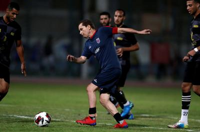Ezzeldin Bahader, a 74-years-old Egyptian football player of 6th October Club is seen in action during a soccer match against El Ayat Sports Club of Egypt's third division league at the Olympic Stadium in the Cairo suburb of Maadi