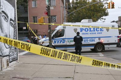 Police are pictured on the scene of a shooting at Triple A Aces club in the Brooklyn borough of New York City