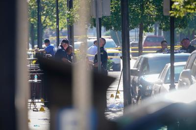 Officials investigate the scene after a mass shooting in Dayton