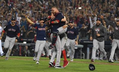 Boston pitcher Chris Sale celebrates with teammates