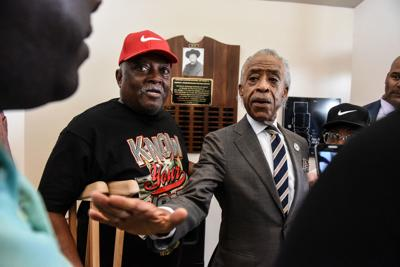 Reverend Al Sharpton from the National Action Network speaks with hecklers after a news conference addressing U.S. President Donald Trump's tweets about Baltimore in Baltimore, Maryland